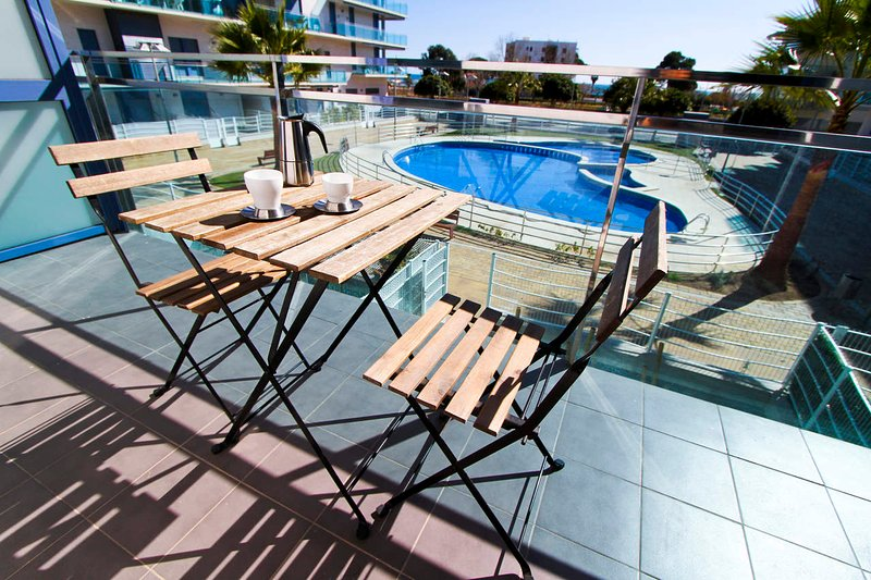 Spacious apartment with shared pool, holiday rental in Vilafortuny