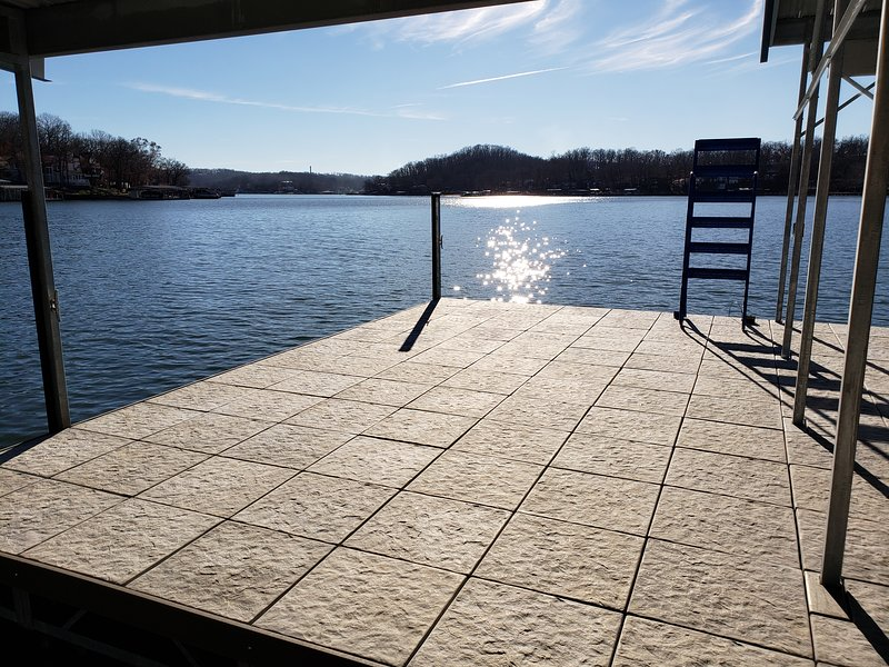 Large swim platform with a ladder to get in and out of the lake easily on the new dock.