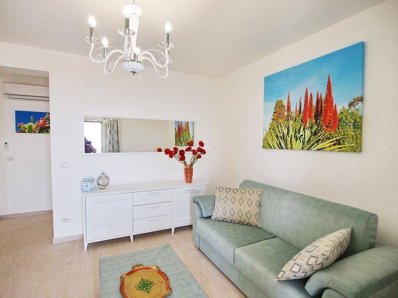 Sala de estar / comedor con sofá cama