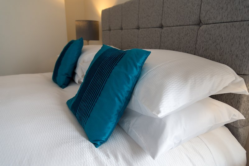 Hotel quality beds with feather duvets and luxury linens