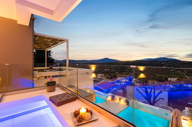 Three Moirai - Boutique villa with two independent buildings on hill slope, holiday rental in Kastellos