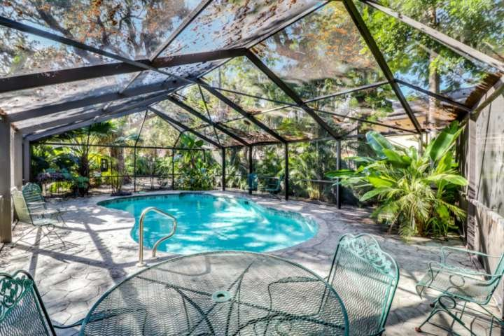 When you aren't at the beach, you'll love the private, fully enclosed pool with expansive pool deck, surrounded with lush, tropical lanscaping.