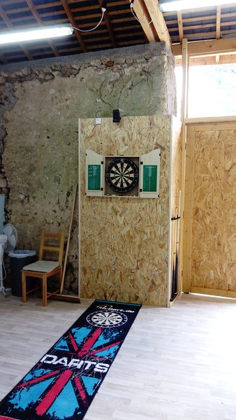 Dartboard with darts, chalk, etc