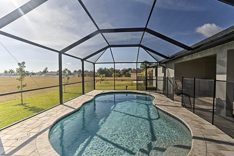 Book your trip to this chic 4-bed, 2-bath vacation rental home in Cape Coral.