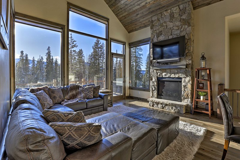 Get cozy next to the wood-burning fireplace while watching the sunset!