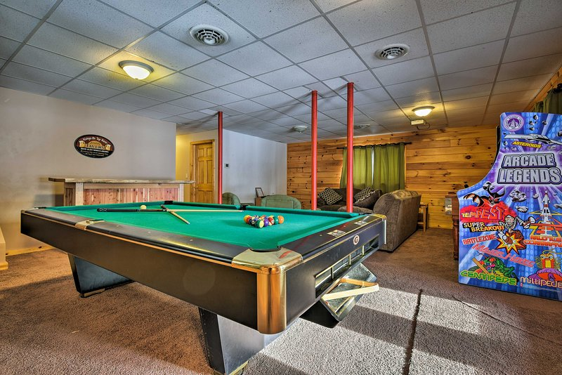 With a game room, home theater, and beds for 24, this home can't be beat!
