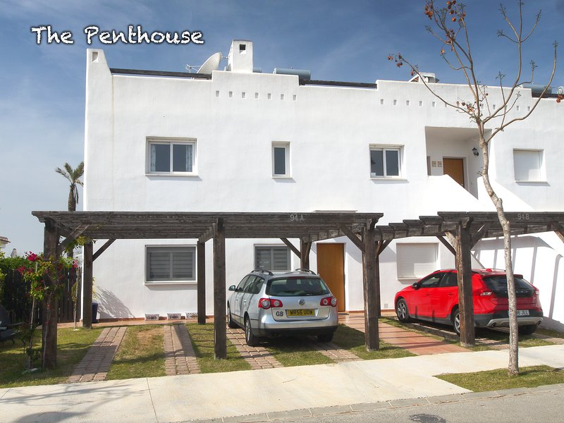 The front of the Penthouse. The Penthouse is the top floor, parking space is the middle drive.