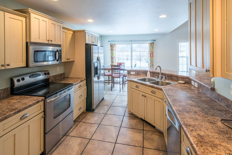 Whip up a tasty meal in the charming kitchen that opens up to the living area, and dining area