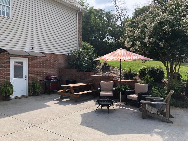 Patio for your use includes propane grill, patio furniture, table and umbrella.