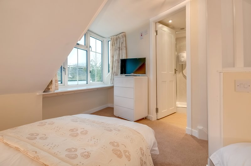 Upper bedroom, twin beds and ensuite shower room