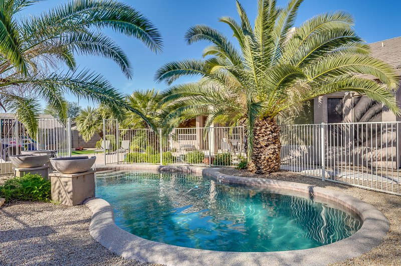 Enjoy swimming in the sparkling pool surrounding by palm trees and beautiful landscaping.