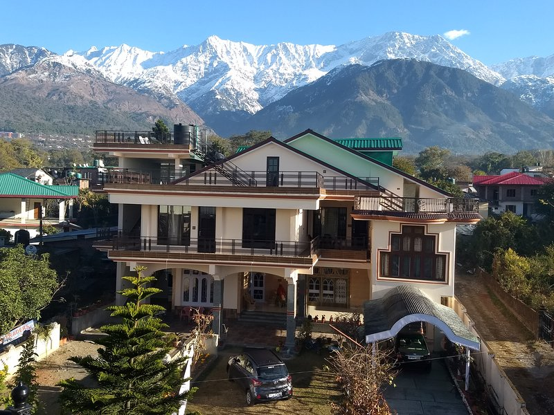 View of property with snow clad mountains in the backdrop..