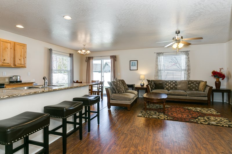 Elegant and inviting open living room/dining room area. Perfect for relaxing and entertaining too.