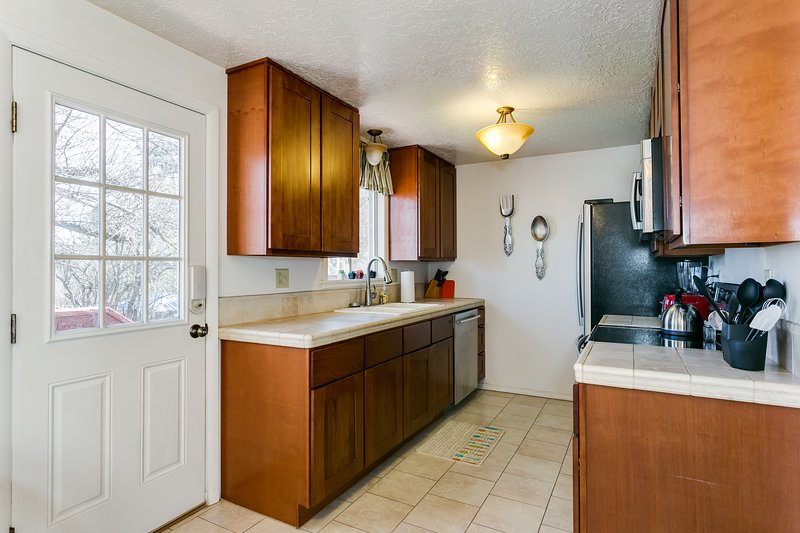 Totally remodeled kitchen with upgraded appliances and tile counters.