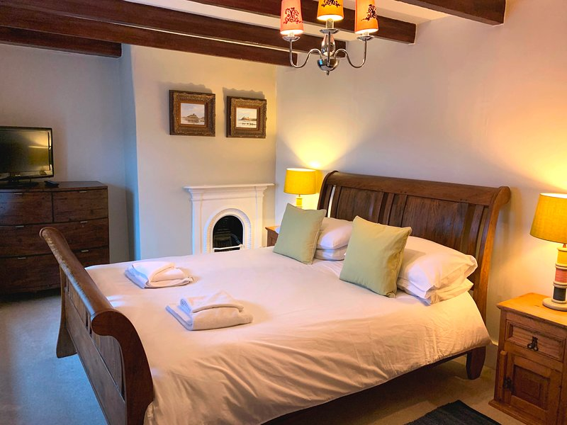 king size bed with tv and views over dunes
