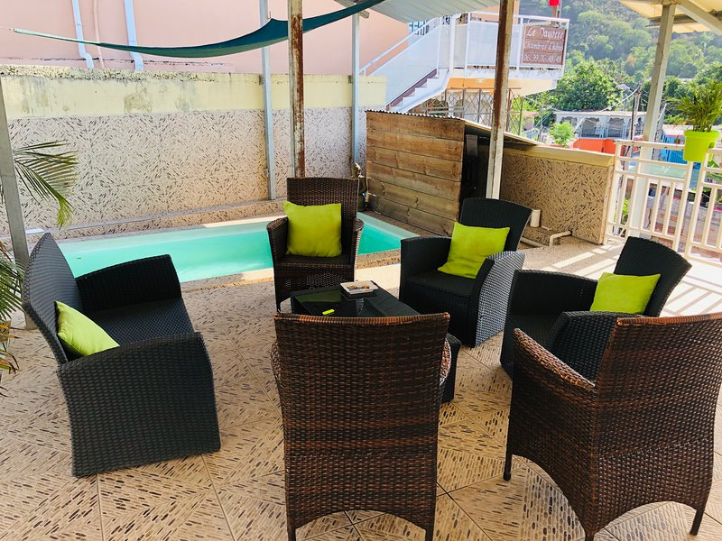 Relaxation area under veranda next to the pool