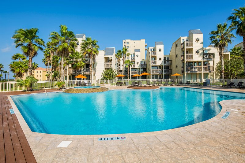 Bright dog-friendly condo w/ large balcony, & shared pool and hot tub!, vacation rental in Port Isabel