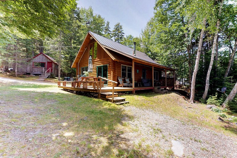 Dog-friendly lakefront log cabin w/ peaceful atmosphere, dock & boat launch!, vacation rental in Jackman