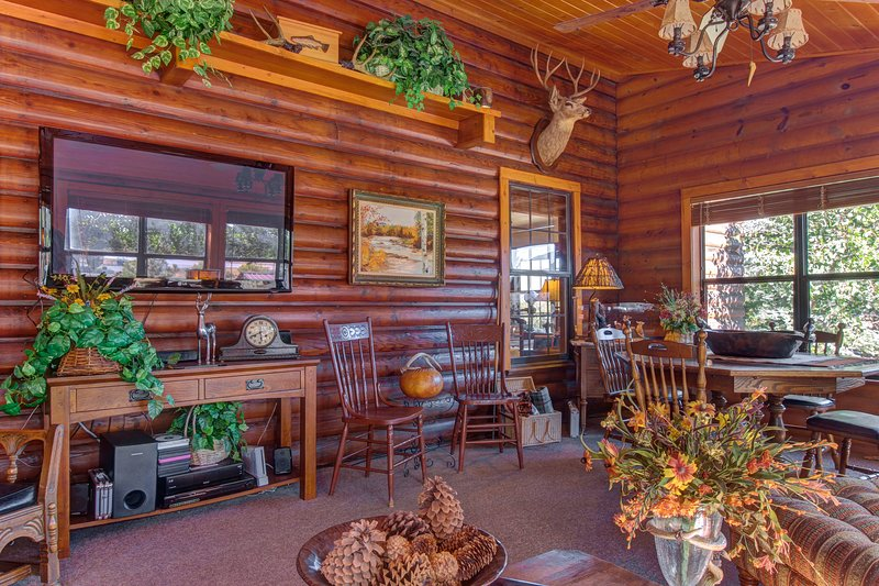 NEW LISTING! Classic log lodge w/shaded porch, patio
