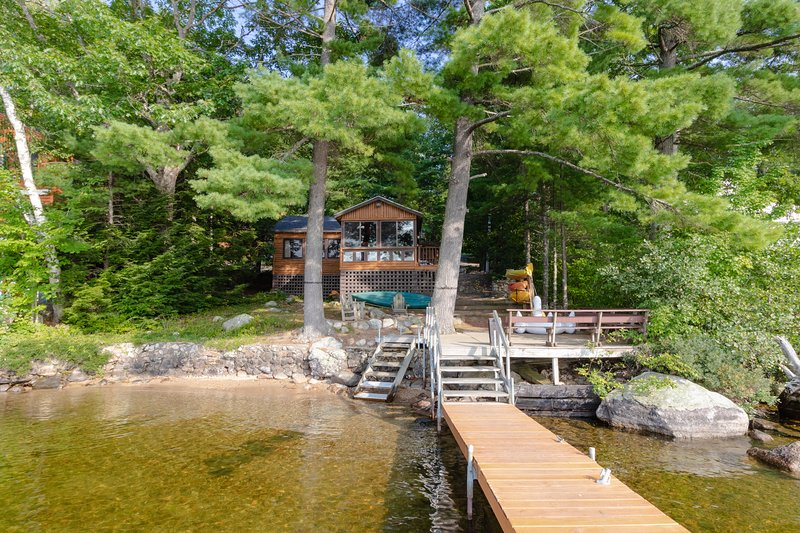 Lakefront cabin w/dock, deck, firepit, paddleboat, 1 dog OK, vacation rental in Naples