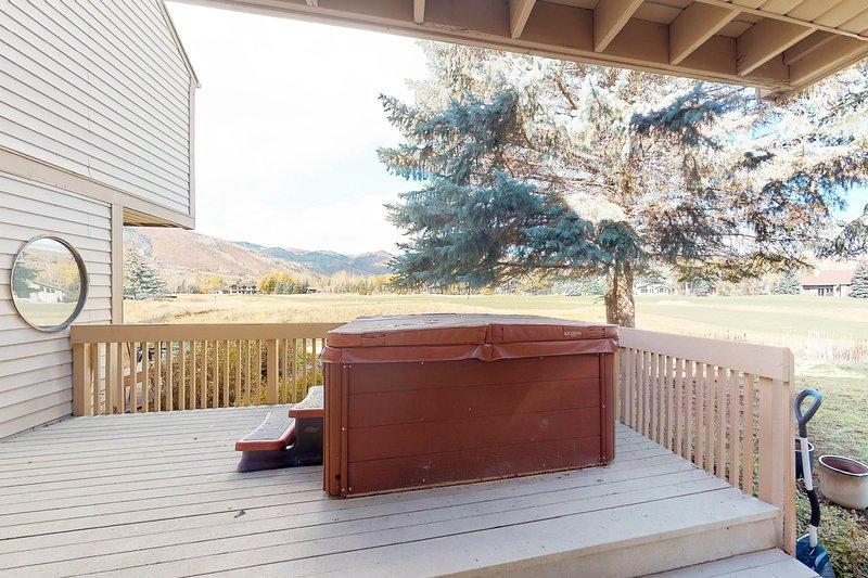 Photo of Golf view condo w/private hot tub, minutes to historic ski resorts