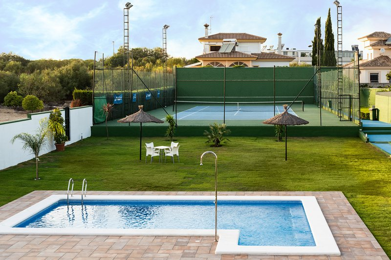 Pool, garden and tennis court