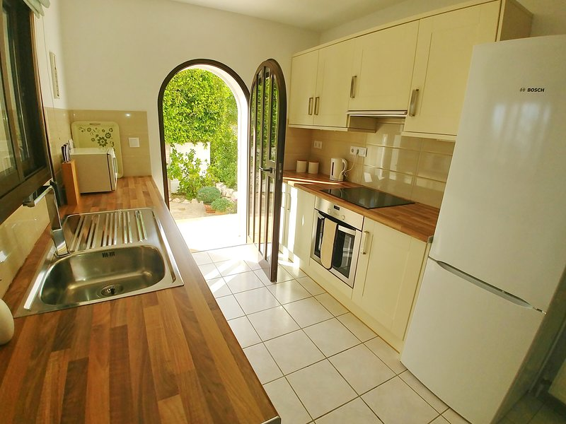 Galley style kitchen with dishwasher, microwave, vitro ceramic hob and oven.
