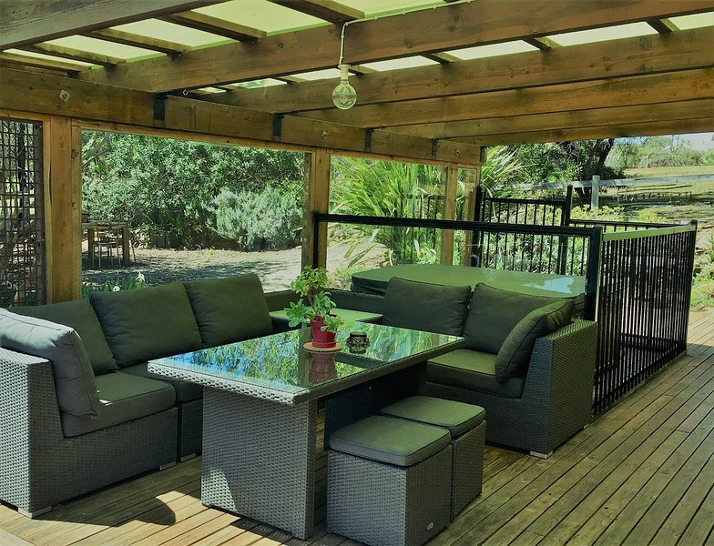 hot tub and outdoor seating on private deck