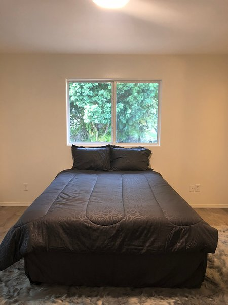 Private master suite boosts a walk-in closet and bonus room complete with air conditioning unit.