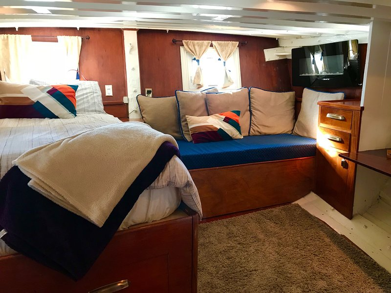 The Owner's stateroom boasts lots of light and sleeping for three, a desk, and private bath