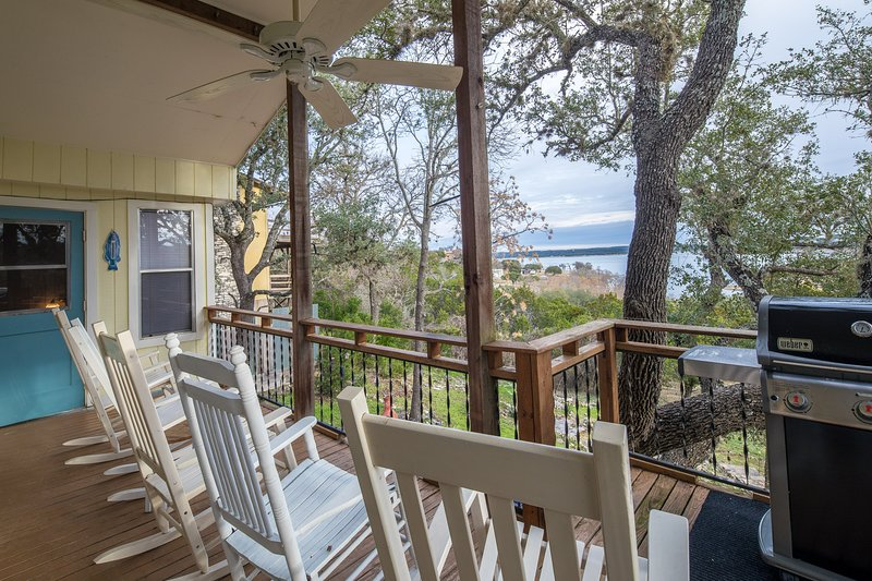 Deck space with comfortable rocking chairs - Gas grill with propane provided