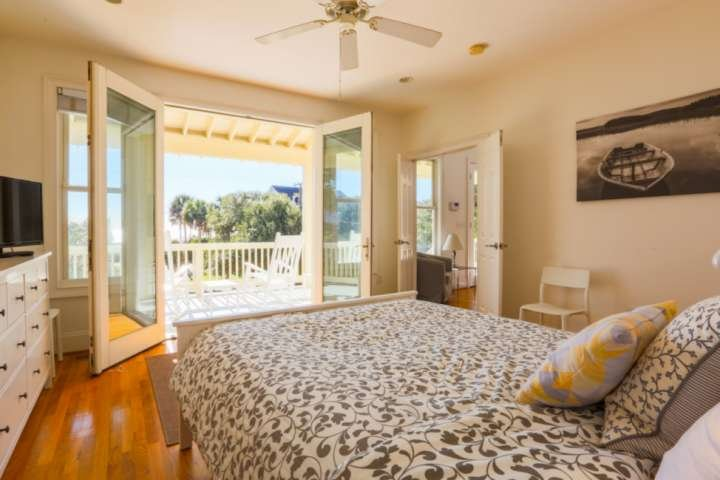Wake up to the ocean! This master bedroom is located on the first floor with its own porch access.