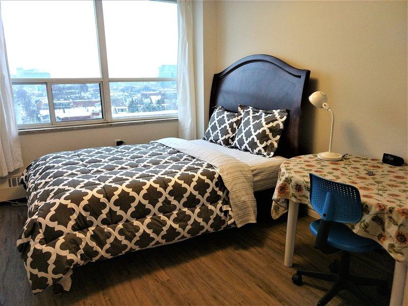 Bedroom with a queen bed, view, plenty of sunlight & ventilation!