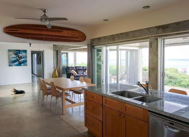 Open concept gourmet kitchen opens directly onto the beach.