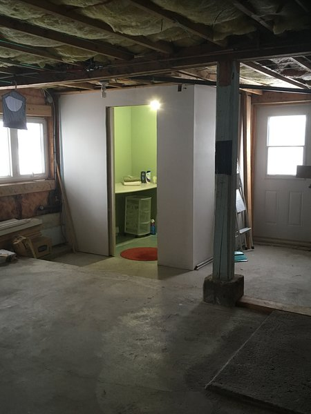 Cross the unfinished basement to the Shower room.