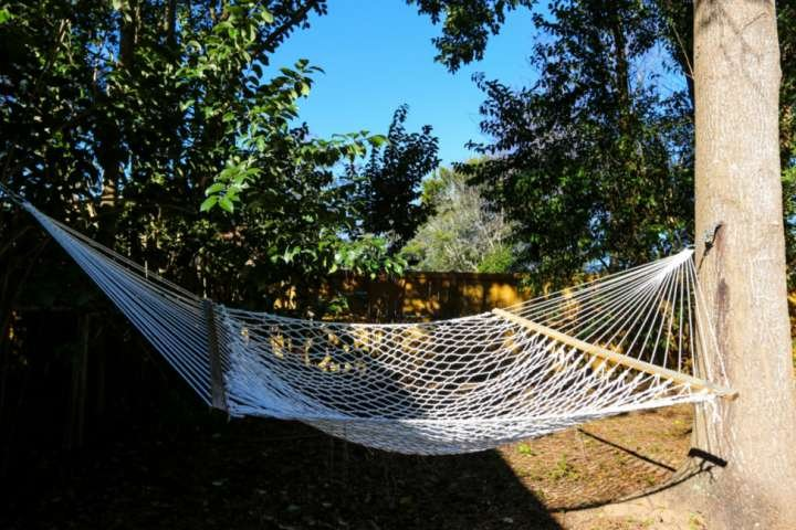 while away some vacation time with a relaxing swing in this awesome outdoor hammock!
