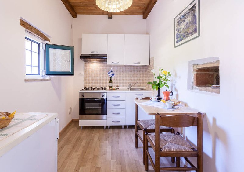 SPELLO VACANZE DANTE'S HOUSE appartamento piano terra, location de vacances à Spello