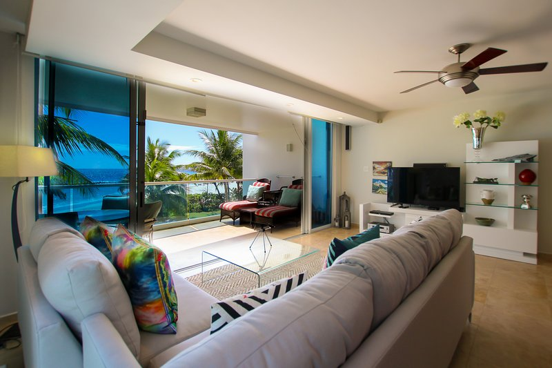 Open plan living area has a comfortable L-shaped couch, wifi, apple TV, DVD player and stereo