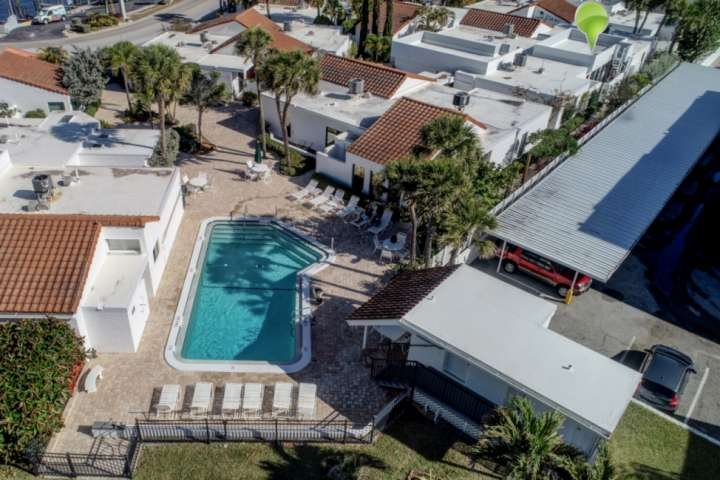 The condo is just steps away from the community heated pool.  From the pool is just steps away from the beach!