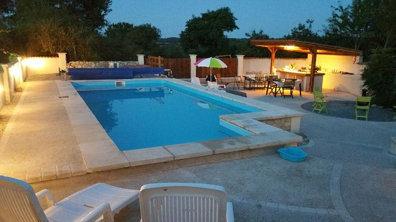 Wall enclosed swimming pool, heated. Kitchen with BBQ gas hob, sink, fridge, speakers, fire pit .ard