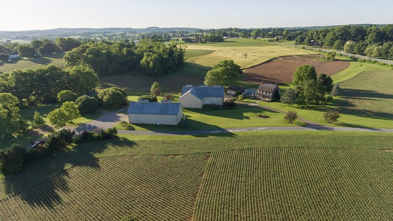 The farmhouse is on an 82 acre farm, surrounded by rolling fields