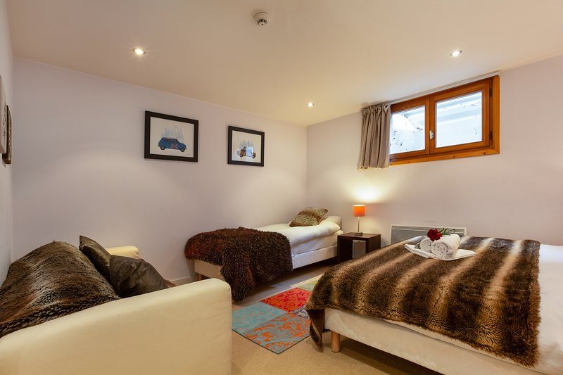 Bedroom 5 with cosy beds and arm chair