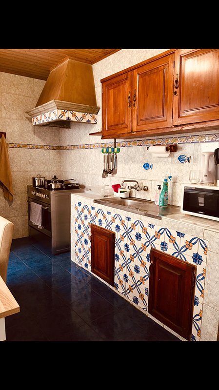 kitchen downstairs with electric stove.Fridge, microwave, expresso machine and toaster pots and pans