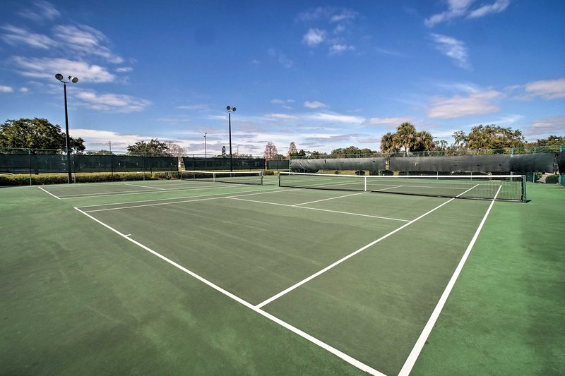 Take the tennis rackets out to the court.