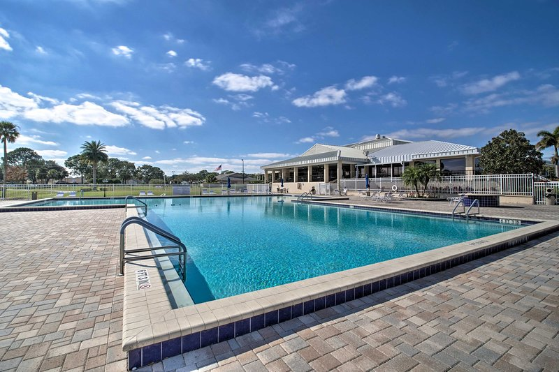 Lounge beside the pool at this vacation rental home!