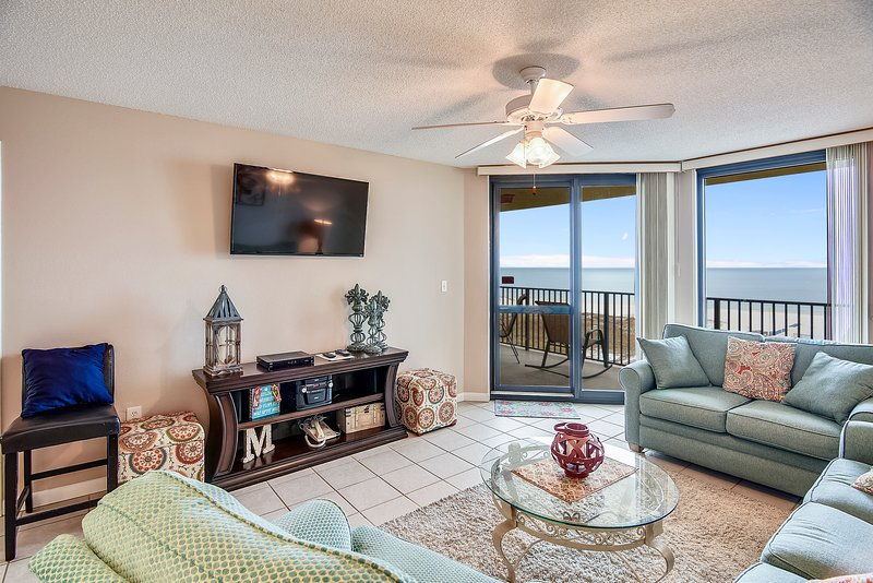 Spacious Living Area with plenty of comfortable seating and views of the gulf.