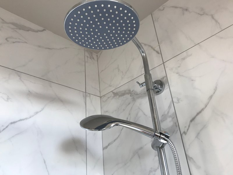 Fixed and hand held shower head to second floor shower room