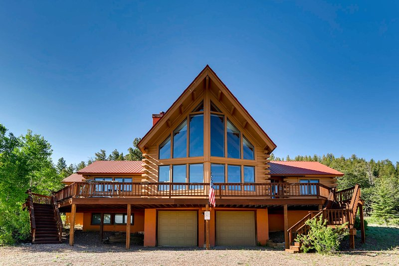 The majestic home has floor to ceiling windows to frame the mountain views.