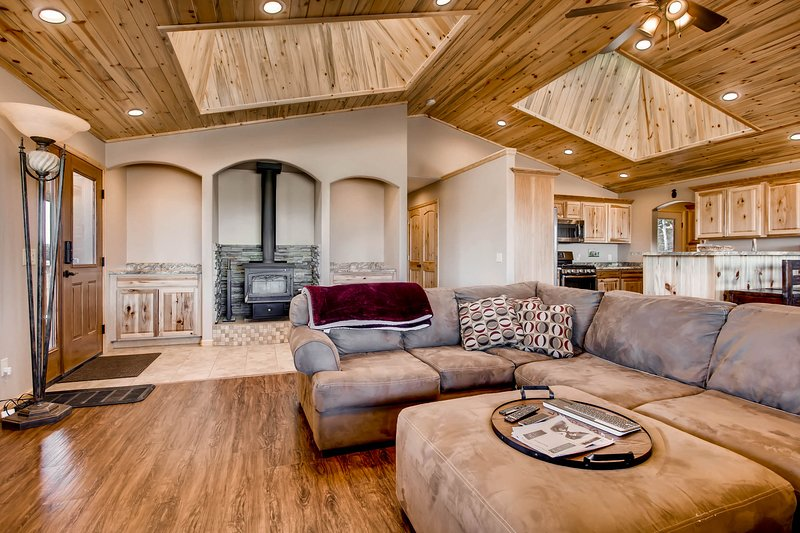 The home has a spacious living area with a wood-burning stove. You will be amazed by the sky lights and wood ceilings.