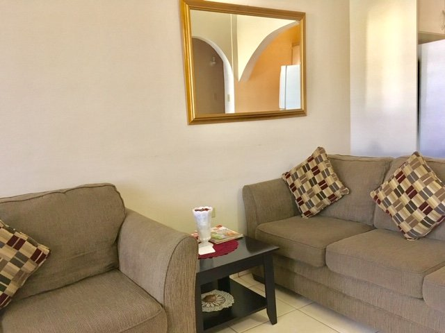 Comfortable couch, love seat in a spacious living room, end tables, contemporary decor! Free WiFi